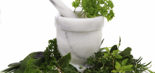 marble pestle and mortar with herbs