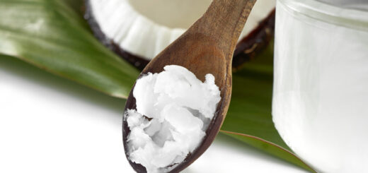 Close-up of coconut oil on the wooden spoon. Beauty and cuisine.